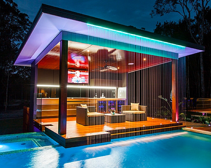 Pool house with bar and waterfall