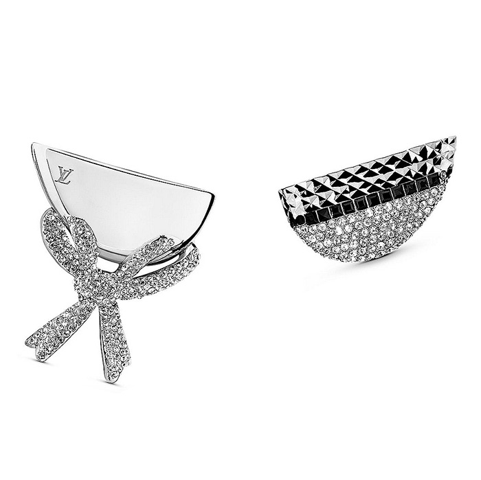 Bionic Earrings Node  $585.00 One is encrusted with sparkling micro-paved crystal strass and the other features a delicate bow and engraved LV Initials