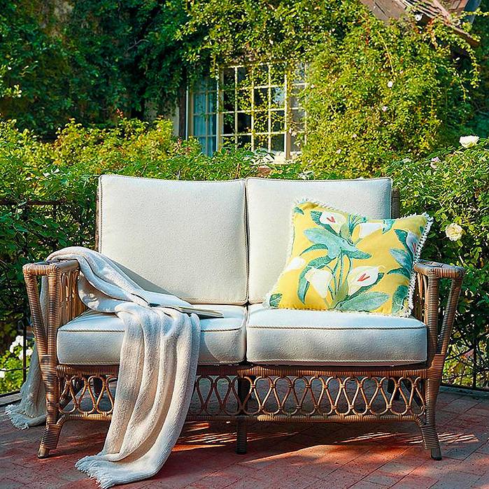 Calla Lily Outdoor Pillow in Sunshine & Myla Loveseat with Cushions in Umber Finish