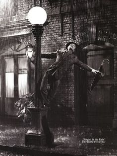 Gene Kelly living it up in the rain.