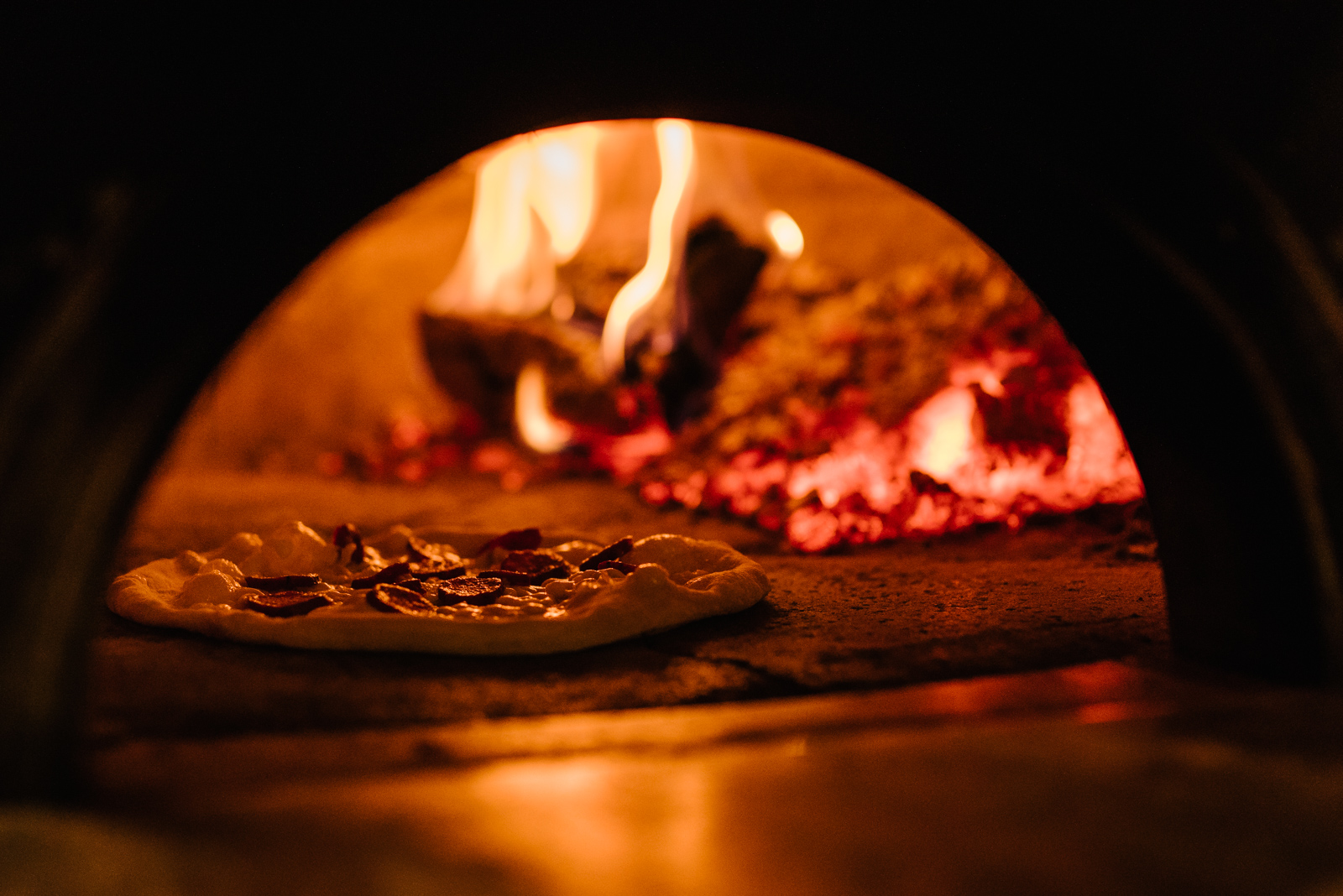Watching the magic happen inside Pizzeria Libretto's oven