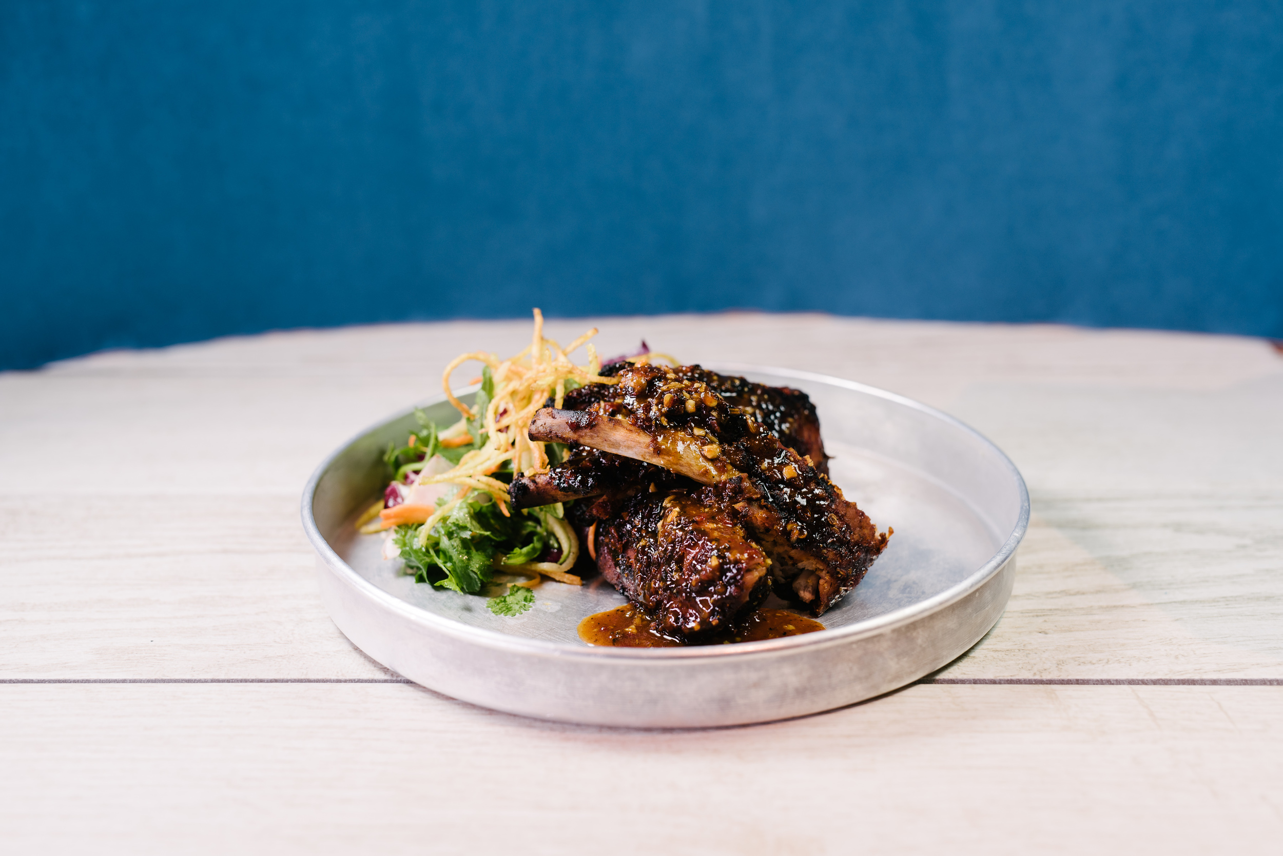 Pukka's Nagaland BBQ Pork Ribs with Slaw and Crispy Chaat. Image by Kyla Zanardi courtesey Samuel Adams.