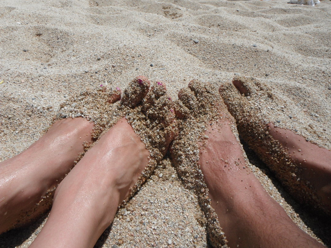 Our toes in the sand on our favourite beach at Sant Pol de Mar. August 2011.
