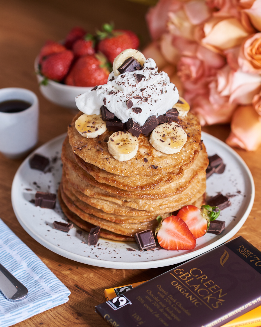 Dark Chocolate Banana Oatmeal Pancakes. Healthy, yet still indulgent. Just in time for Mother's Day Brunch.  Photo by Tobias Wang.