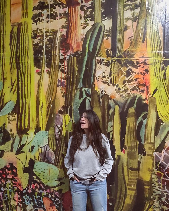 Hey it's officially summer! Here's me wearing a sweatshirt in front of a mural of cacti! Happy solstice! 🌞🌵 . . . . . . . #summer #happysummer #summersolstice #detroit #downtowndetroit #travel #nightlife #lolarhodes #singersongwriter #adventure #cacti #streetart #mural #vibes #longhair #happyfriday #friday #weekendvibes #tourist