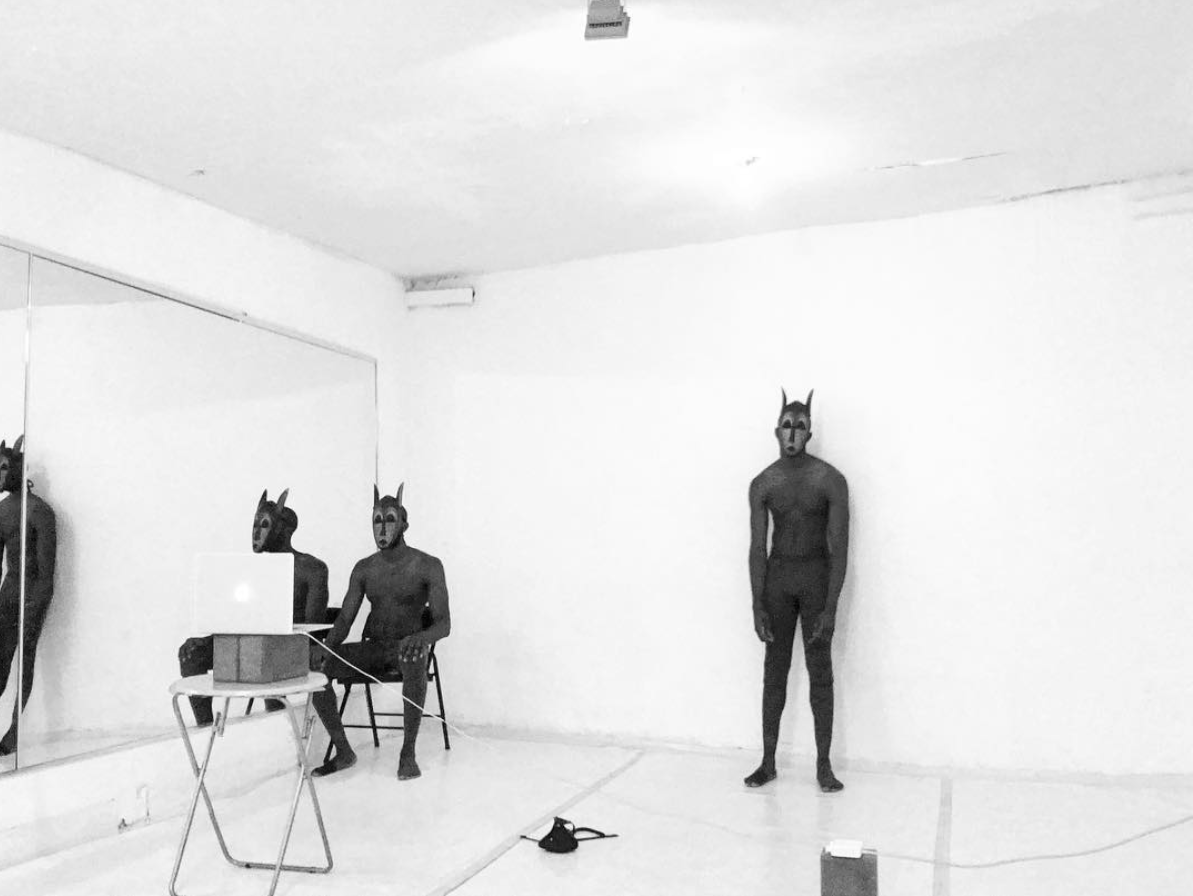 #MASCULINEKEN  is an ongoing performative series featuring an expressionless humanoid character of unintelligible African origins portrayed by Jerome AB and extensions thereof, dubbed Masculine Ken. In these pieces, Masculine Ken observes and confronts various psychological defense mechanisms, processes and falsified intrapersonal realities defined by (in)human(e) exchanges through movement and visual audio manipulation.