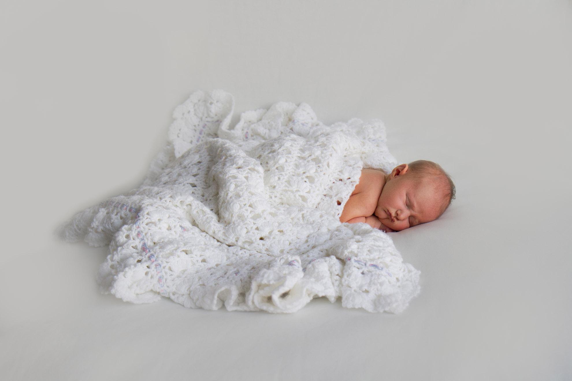 Newborn-photo-with-family-shawl.jpg