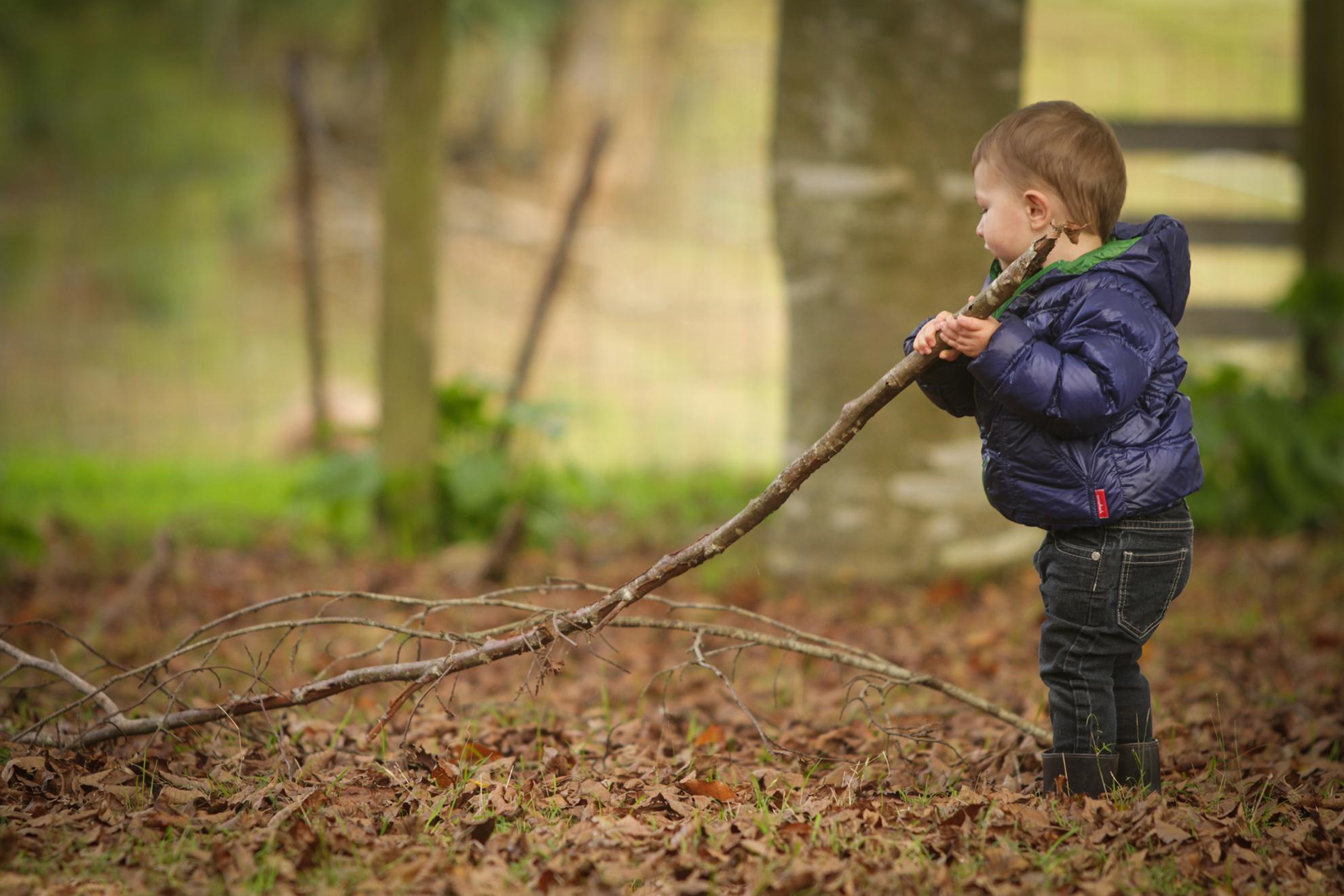 Hamilton-photographer-child-playing-with-sticks.jpg