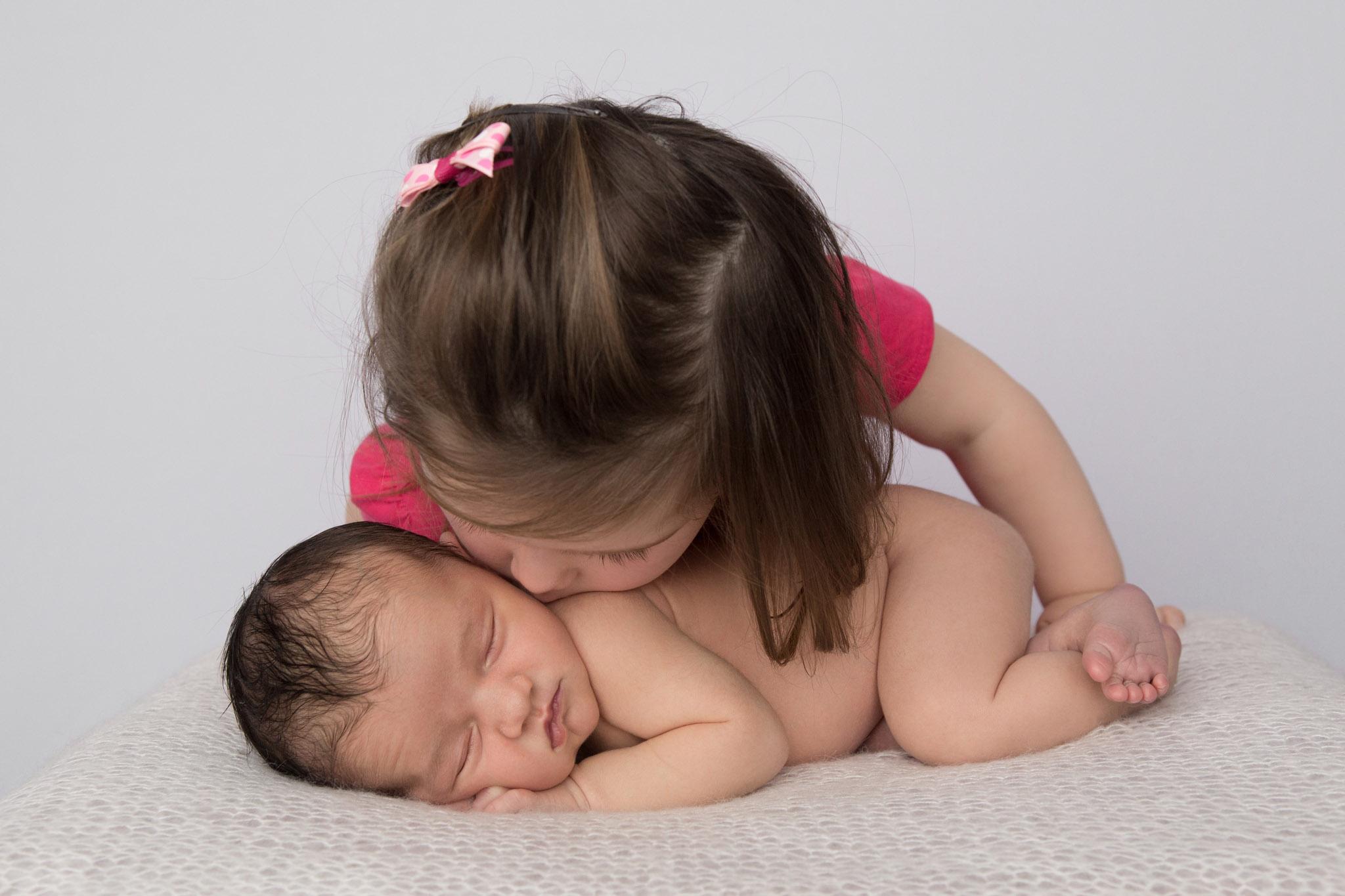 Baby-with-big-sister.jpg
