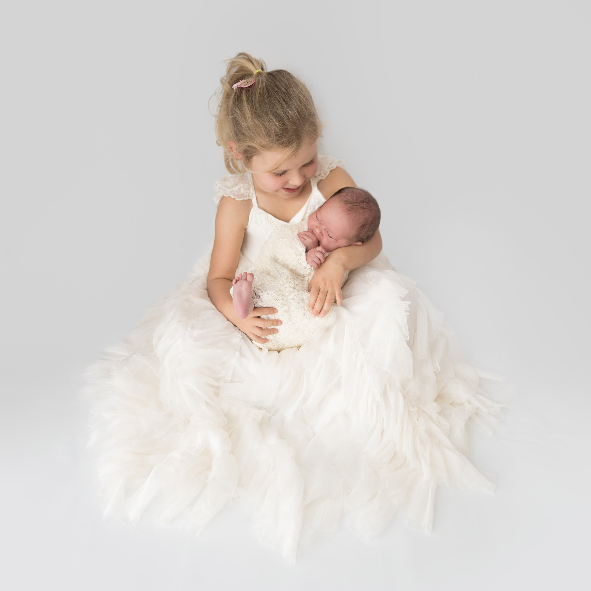 A princess dress, lace wrap, and two gorgeous sister