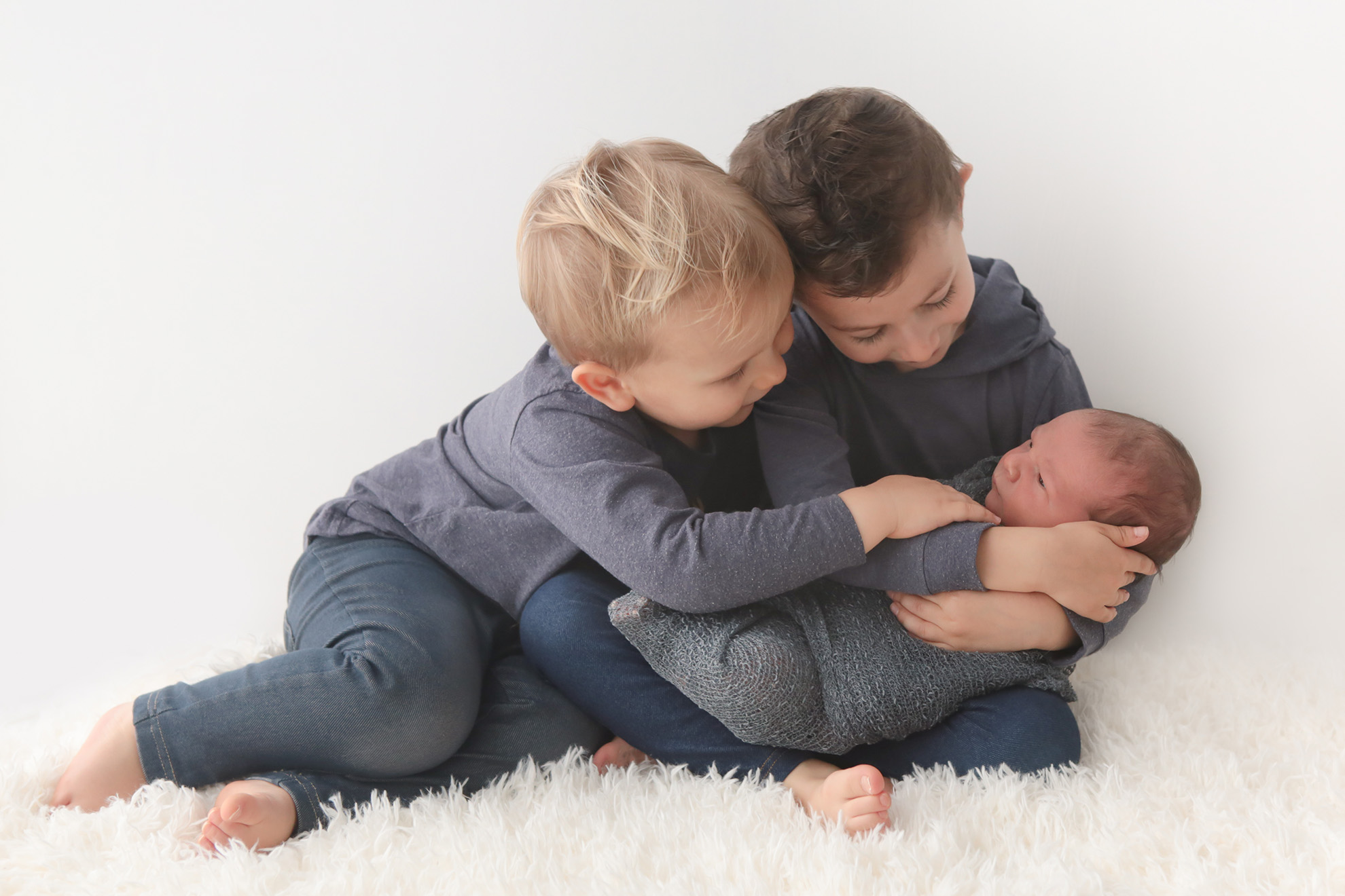 Newborn-baby-and-siblings-photography.jpg