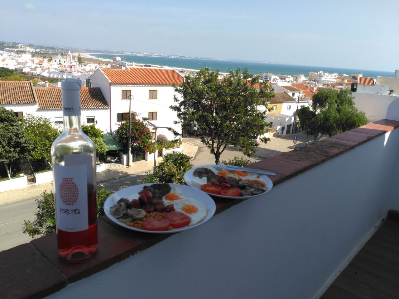 Breakfast and rosé on the balcony.