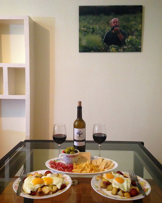 Sam and my first dinner in our new home would have been incomplete without a bottle of Rioja red. The photo of the man eating grapes in the background came with the place and our landlord gave us a bottle of wine as a welcome gift!