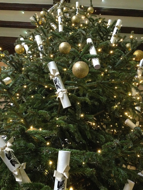 Giant Christmas tree in the castle decorated with Christmas crackers