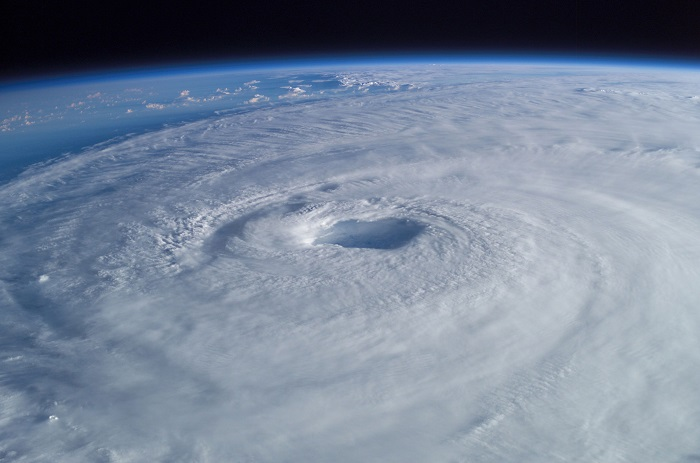(From his vantage point high above the Earth in the International Space Station, Astronaut Ed Lu captured this broad view of Hurricane Isabel.  Image  courtesy of Mike Trenchard, Earth Sciences & Image Analysis Laboratory, Johnson Space Center. September 15, 2003.)