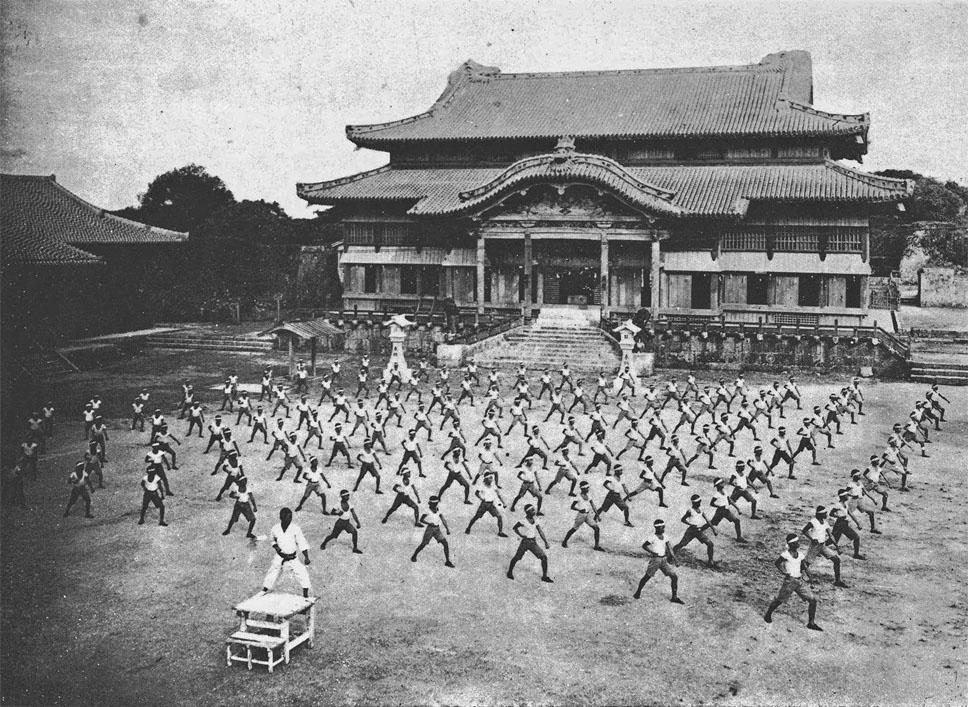 KARATE TRAINING WITH SHINPAN GUSUKUMA SENSEI AT SHURI CASTLE  C. 1938, OKINAWA PREFECTURE, JAPAN.
