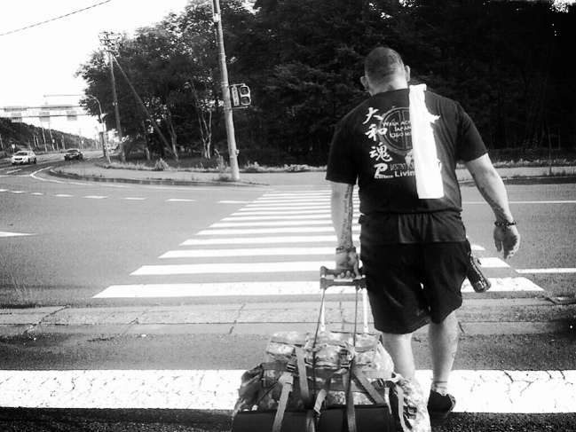 Enson begins his walk...