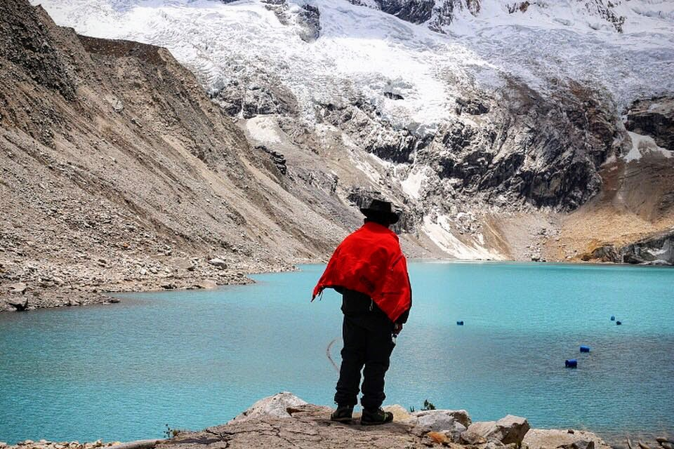 """(""""Glaciers melt into overfull and unstable high alpine glacier lakes above the homes of hundreds of thousands of people in la Cordillera Blanca. This photo is of one of the handful of guardians tasked with keeping watch and alerting the towns below in case of disasters."""" 