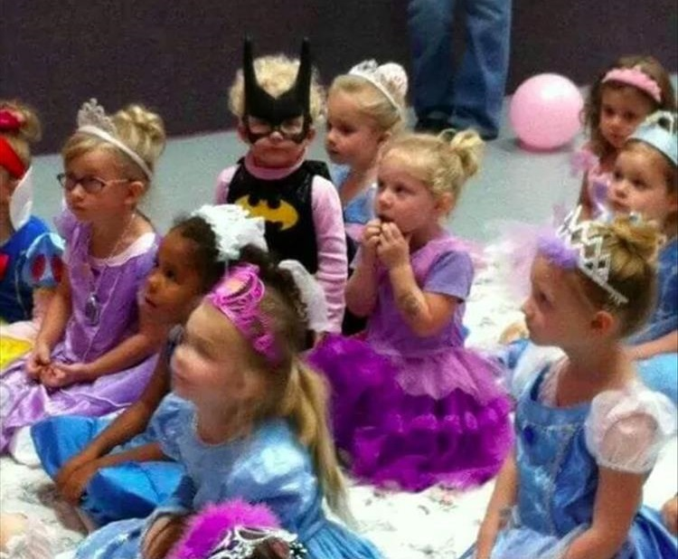 Little Batman in a sea of princesses