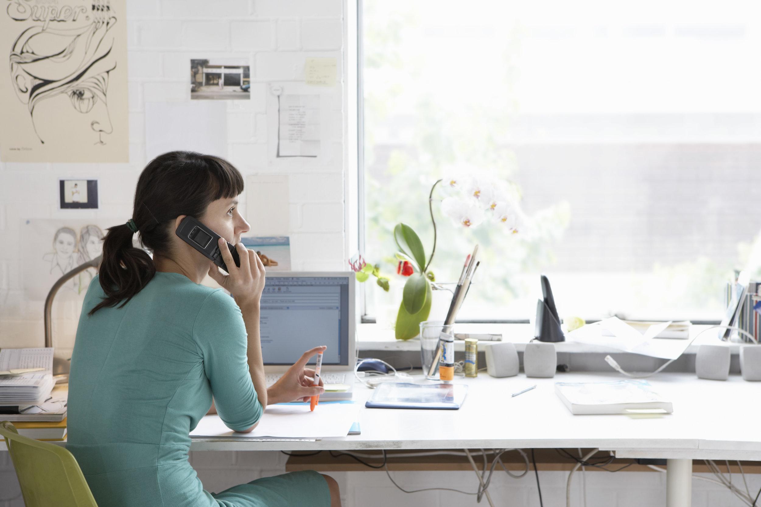 Designer sitting at desk.jpg