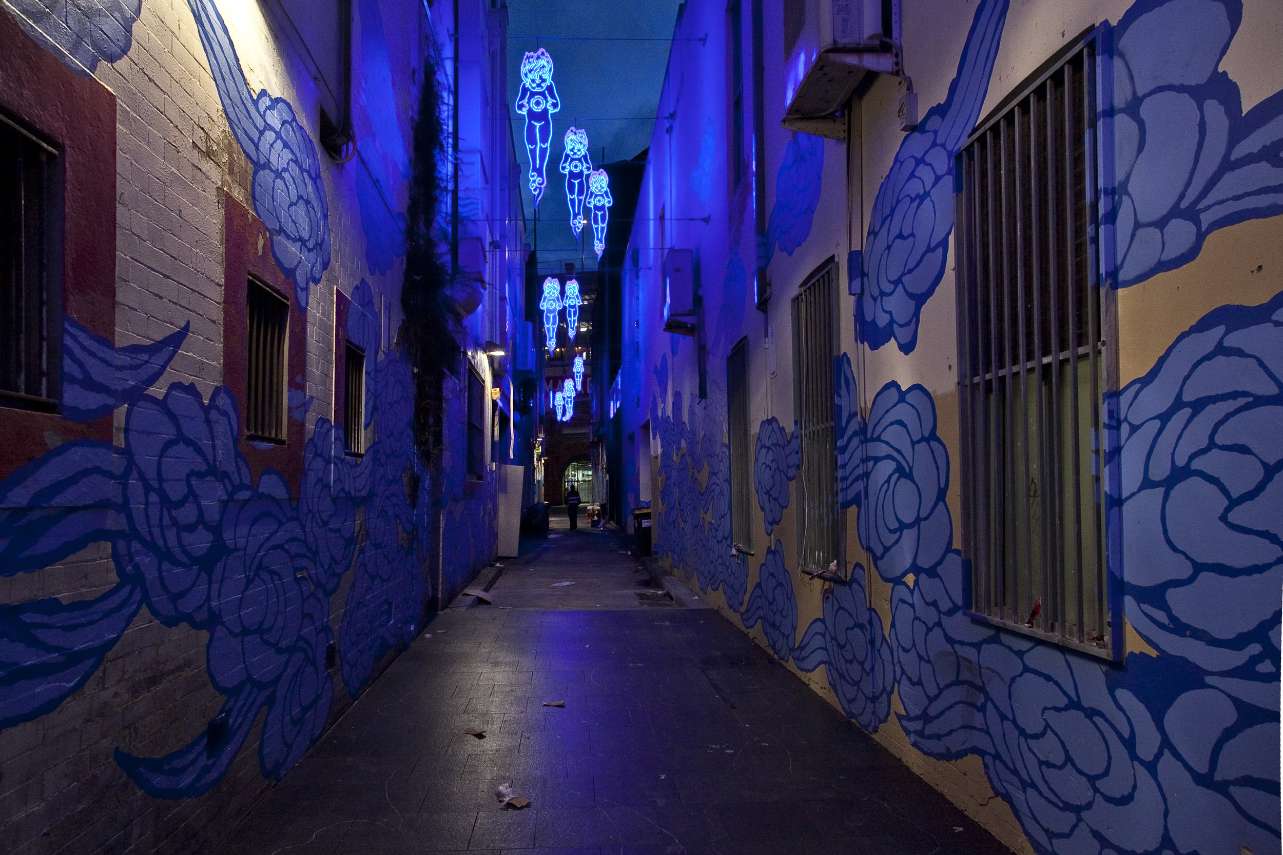 Jason's mural transforms into a light installation at night.