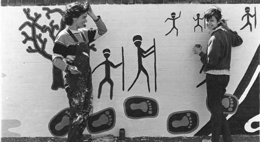 Artists Tracey Moffat and Avril Quaill painting the 40,000 Years in 1983. Photograph by Carol Ruff courtesy of Barani