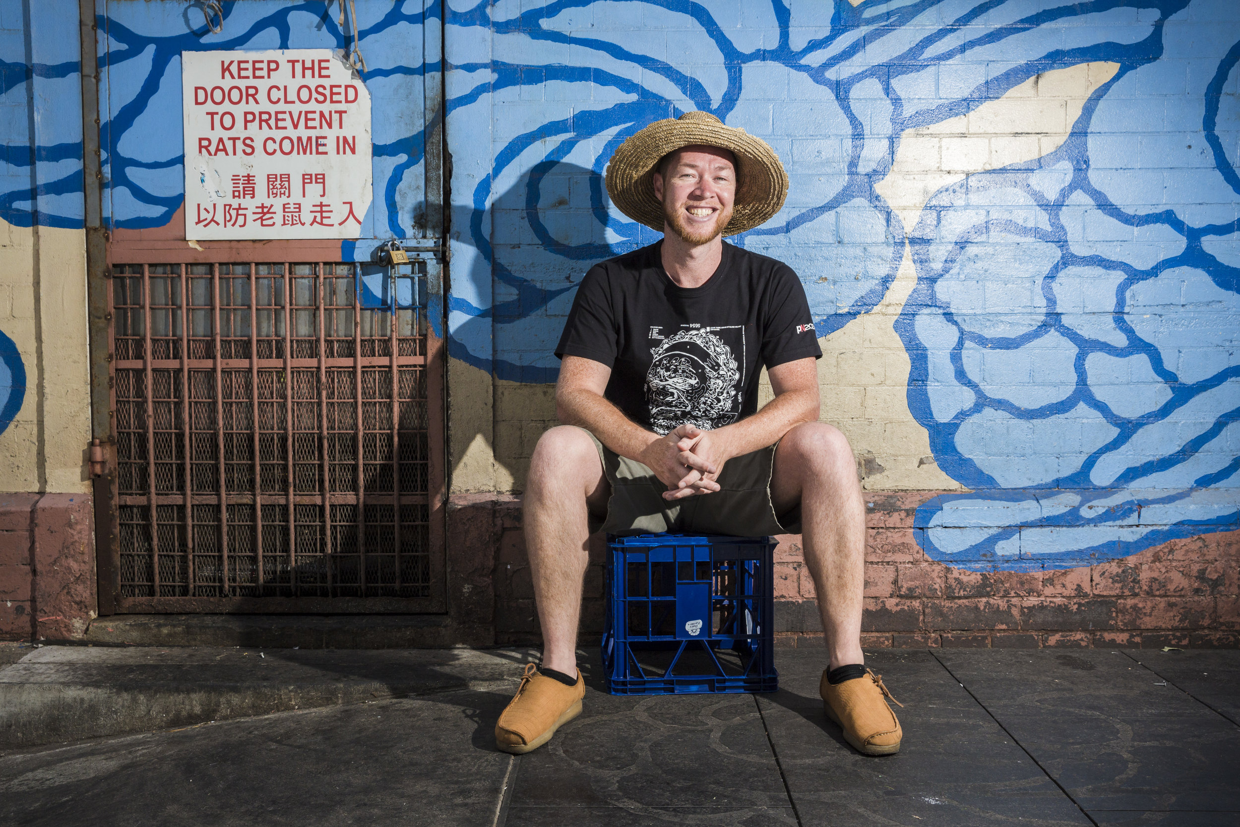 Artist Jason Wing in front of one of his murals in Chinatown. Photo by Daniel Boyd