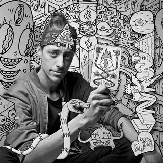 CRAIG - Drawing his imagination from a freakishly divine higher power, BUNKWAA is a self-proclaimed visionary cartoonist. Known as the Alex Grey of the cartooning world, his images are a kaleidoscopic caricature of the higher dimensional planes of existence. Full of character, worlds within worlds and faces within faces, these cartoons are a sleight of hand journey into an uncanny realm. Explore a multi-dimensional world made of pure forms and archetypal characters. Like an inter-dimensional wonderland, you become Alice, as your eyes peer further and further down the rabbit hole.BUNKWAA leads a mysterious double life as 'Craig Bunker' - a Culture Scout who runs regular street art walking tours through Sydney's Inner West.