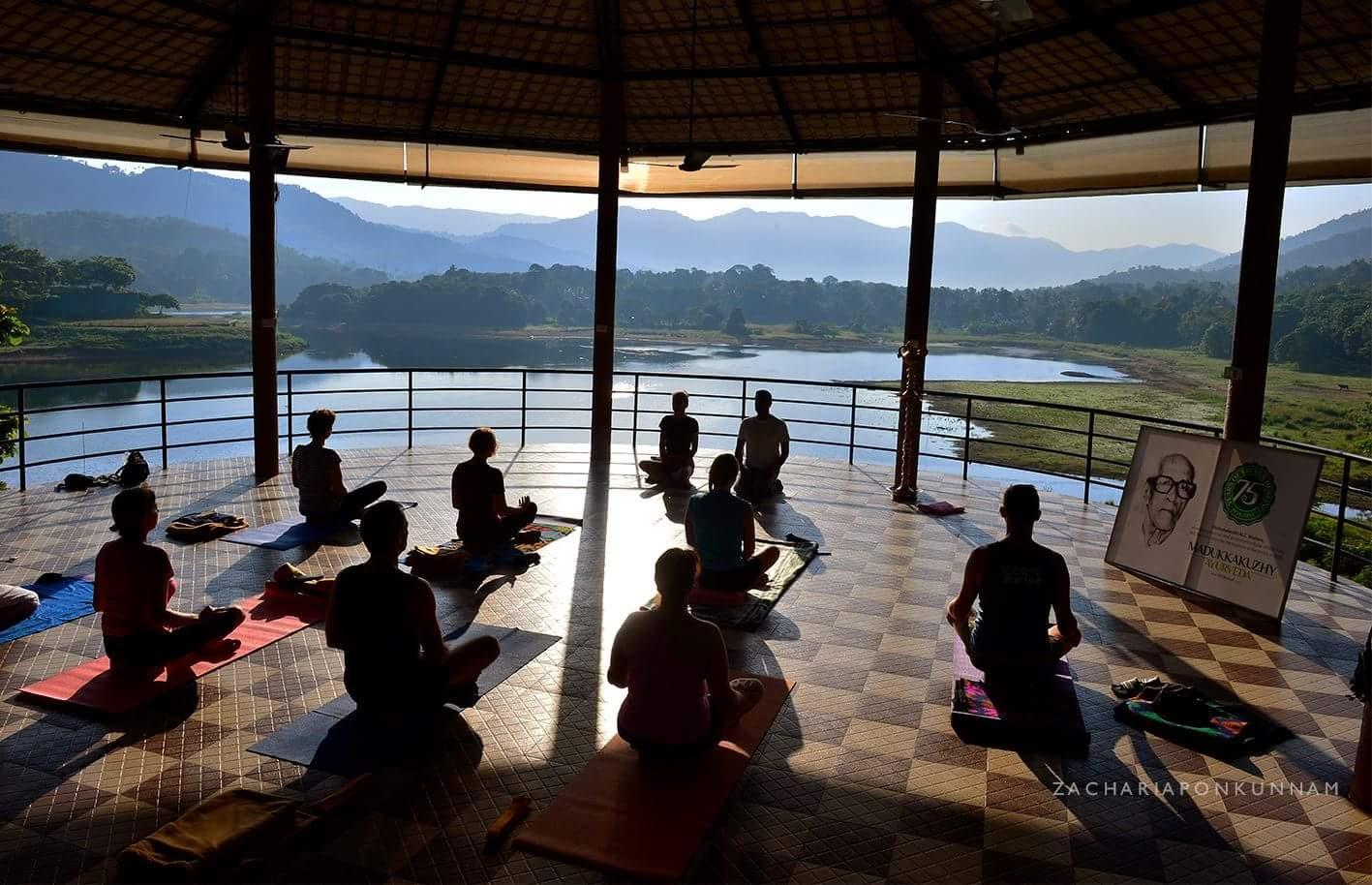 Experiene the power of yoga at the serene landscape at Kudayathoor, Kerala, India
