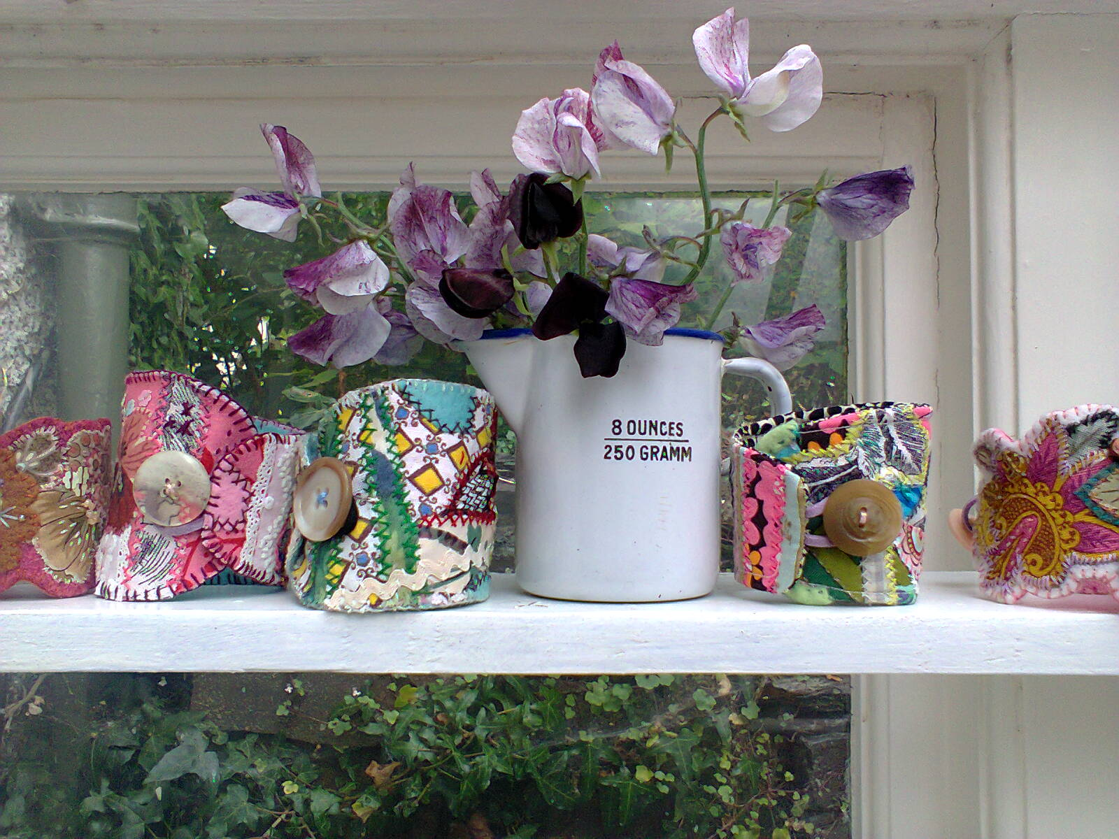 The textile cuffs I made looked lovely with these sweet peas.