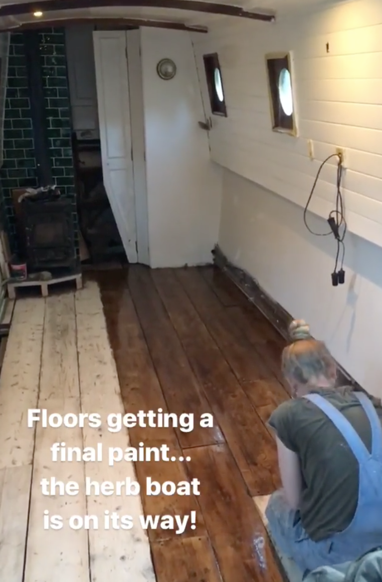 New scaffolding-board floor being painted June 2018