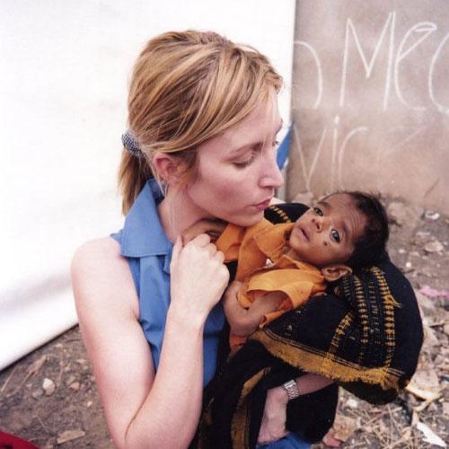 Heather-with-Baby-outside-hospital,-full-shot.jpg