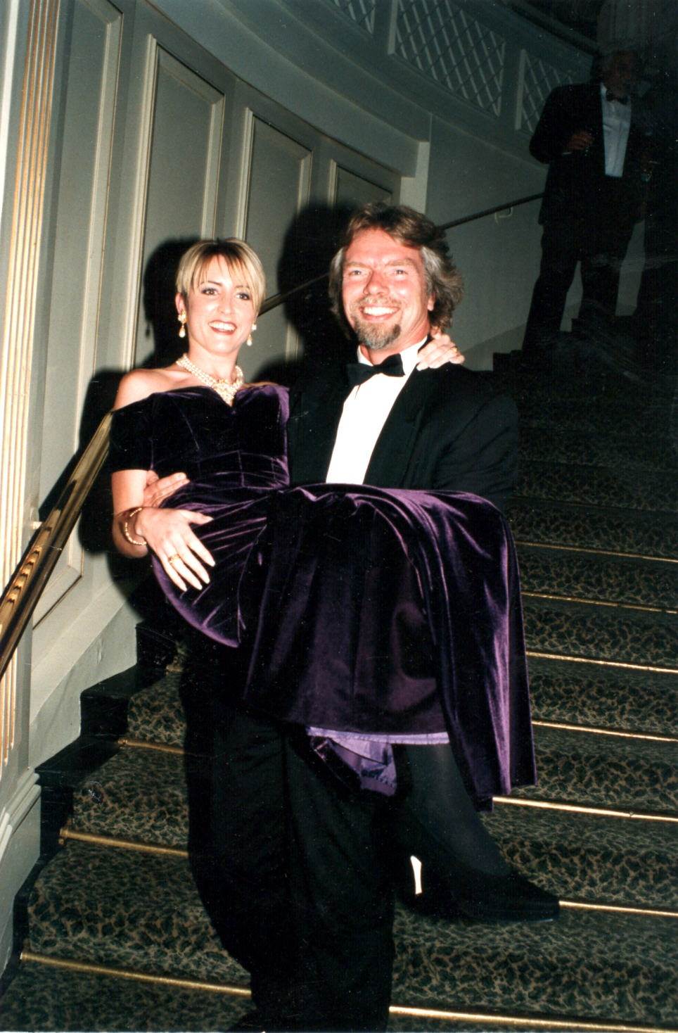 Richard Branson carry Heather at the 1996 Outstanding Young Person of the Year Award with Heather was awarded.