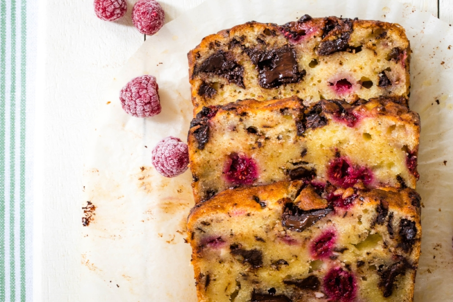 Thick slices of steam oven raspberry and dark chocolate loaf cake