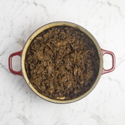 Beef cheek taco filling, cooked and shredded.