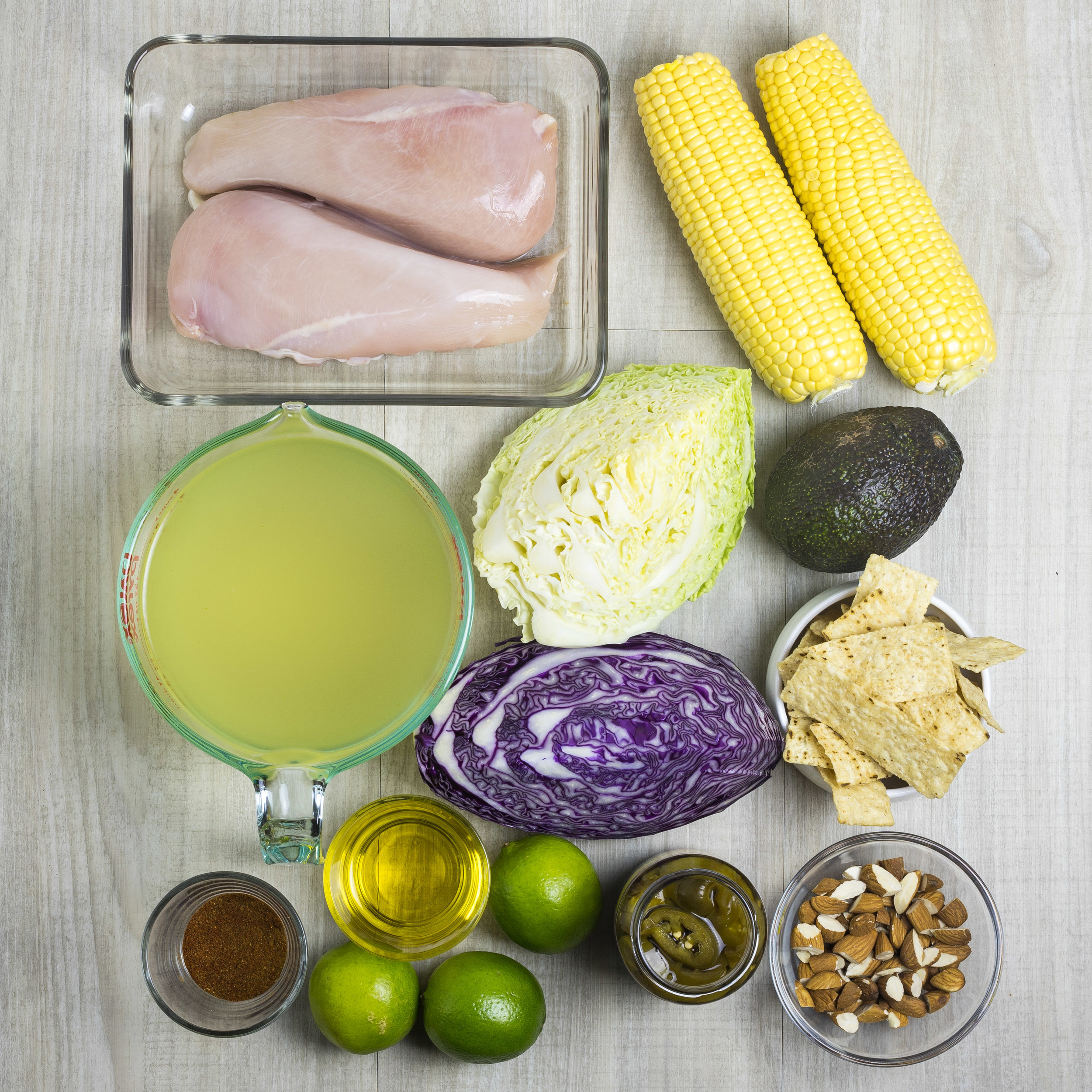 Ingredients laid out in dishes, ready to make Mexican poached chicken salad.