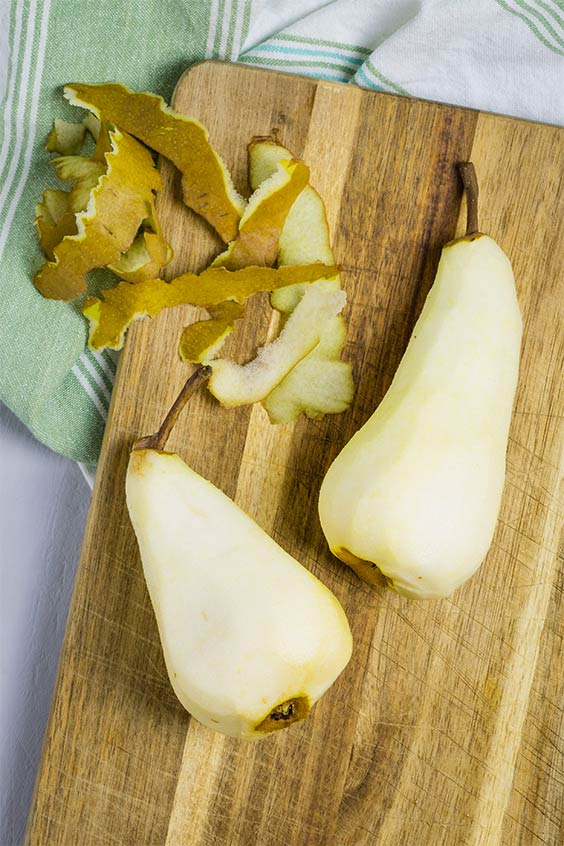 Peeled pears on a board ready to chop