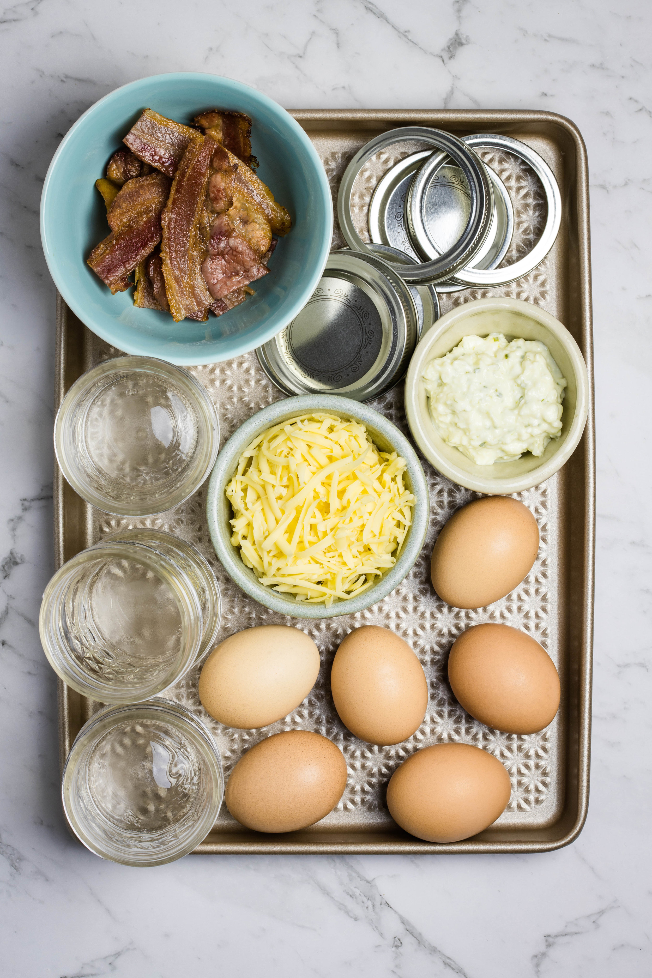 Alternate ingredients for sous vide egg bites, eggs, cheese, bacon and cottage cheese with herbs