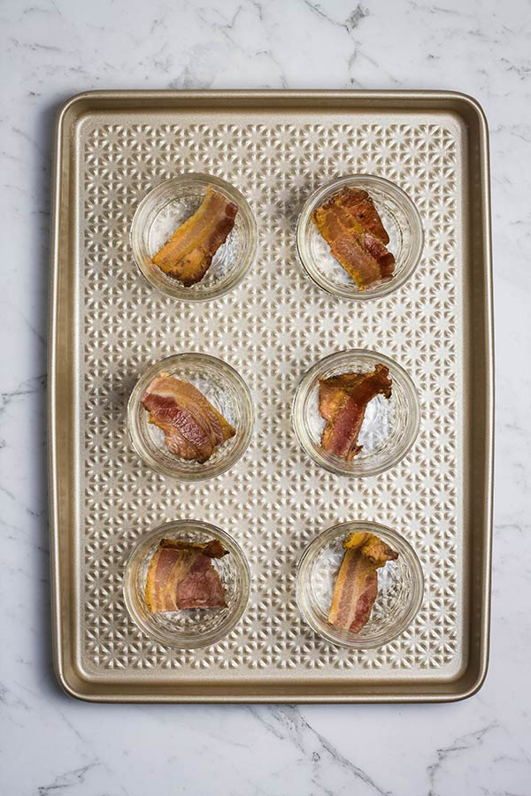 Slices of bacon in jars, ready for sous vide egg bites filling