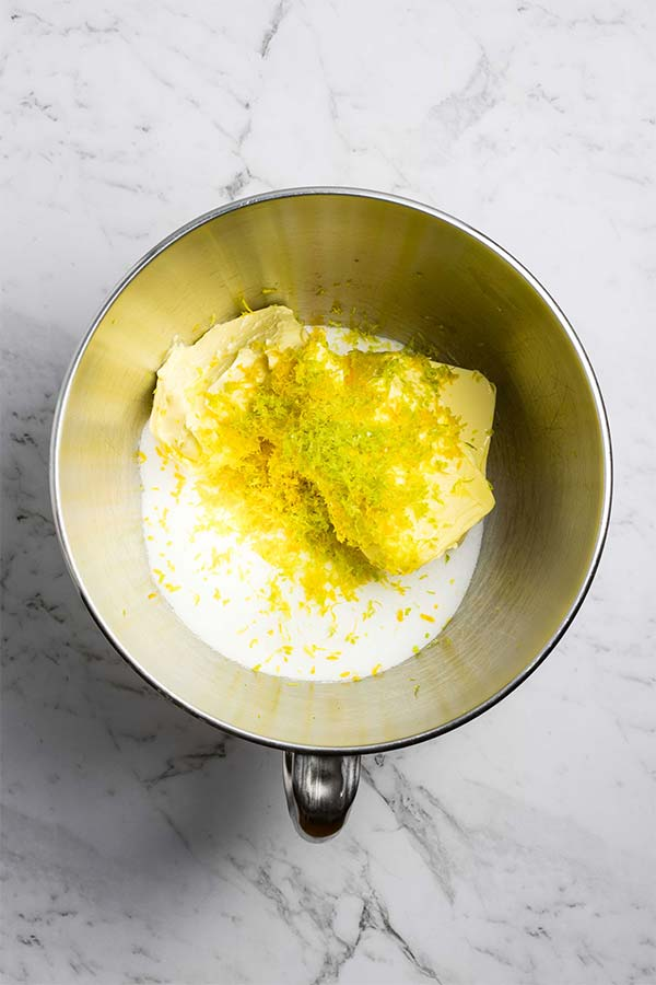 Butter, sugar and citrus zest in a bowl.