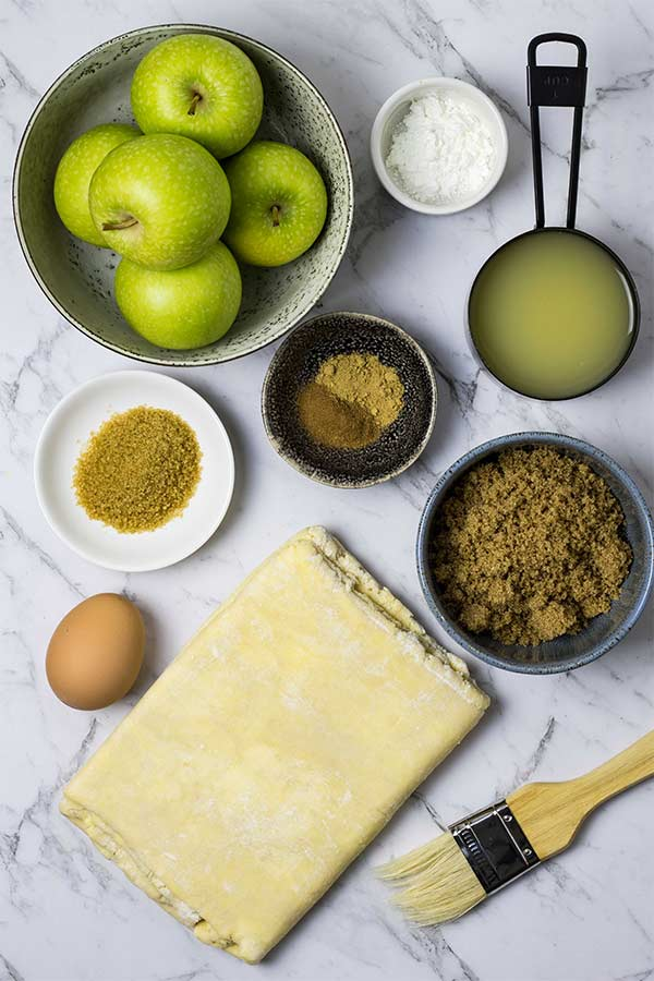 Ingredients for apple turnovers, laid out for baking.