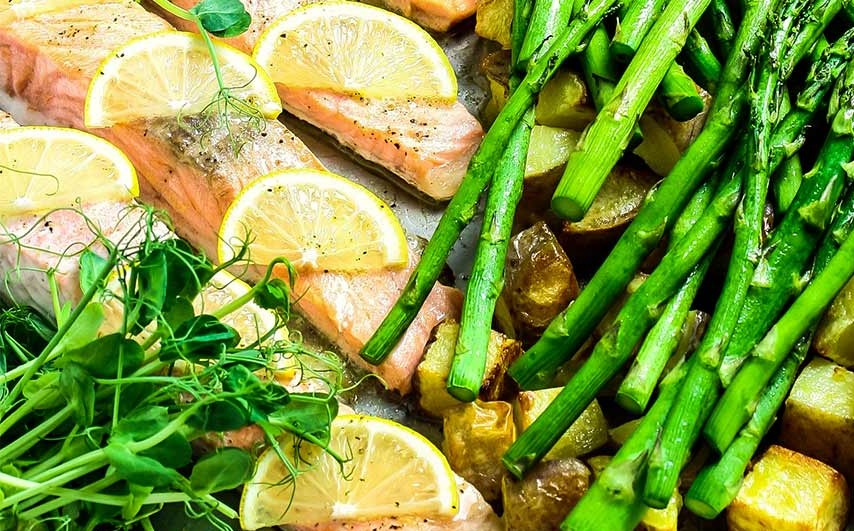 Salmon, asparagus and cubed potatoes cooked with lemon slices. One of the top 10 steam oven recipes.