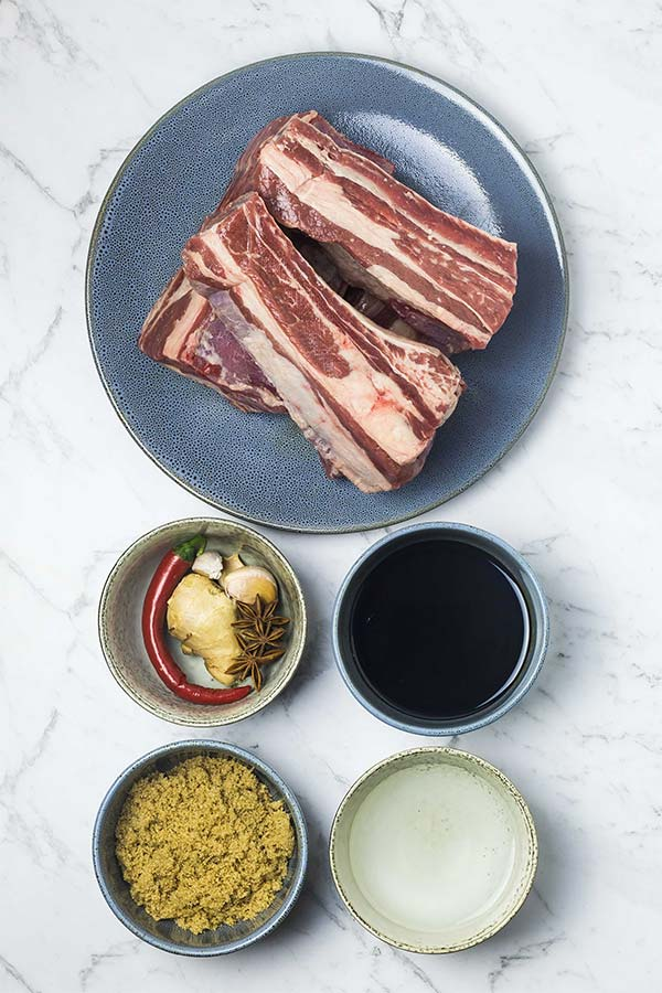 Ingredients for sticky Asian style beef ribs: beef, soy sauce, water, brown sugar, ginger, garlic, chilli and star anise.
