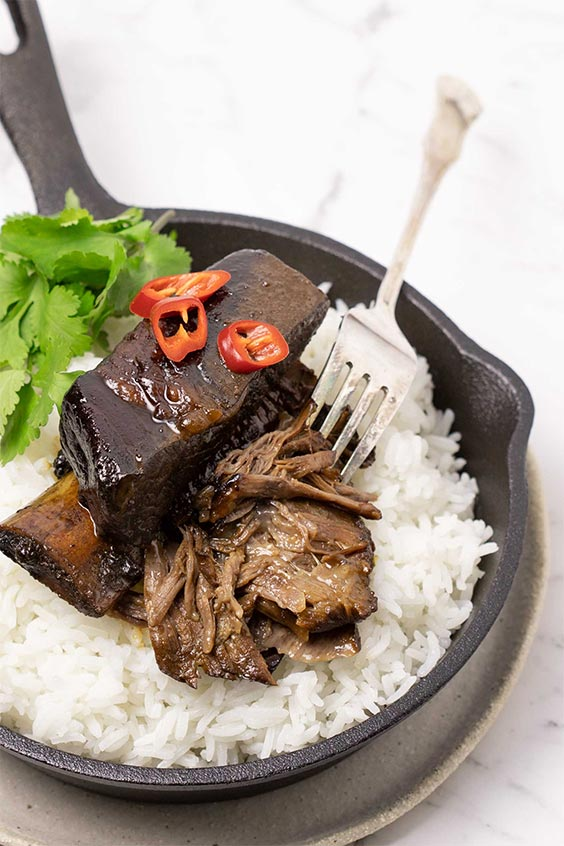 Steam oven sticky beef ribs with rice, coriander and chilli.