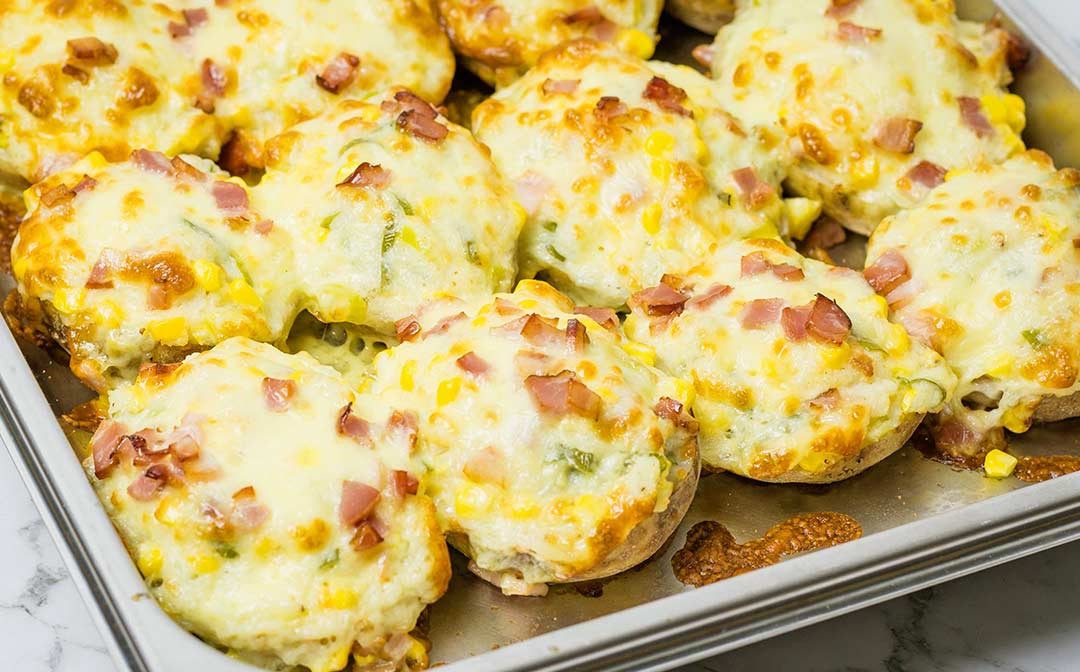 Twice baked potatoes in a baking dish, ready to serve.