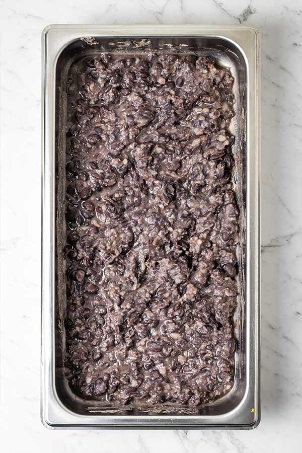 Roughly mashed black beans for sweet potato tacos