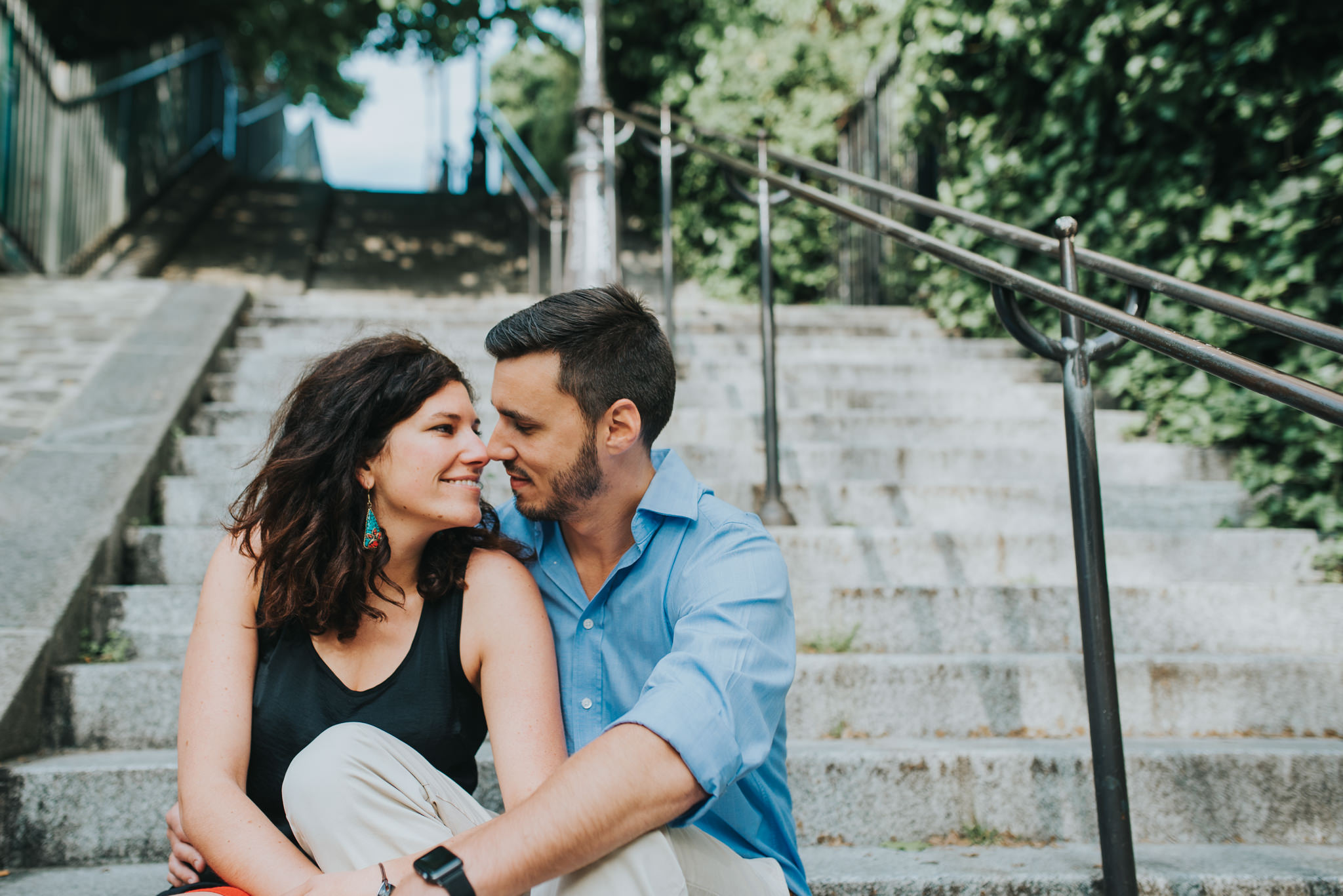 couple in love sitting on steps in Montmartre, Paris
