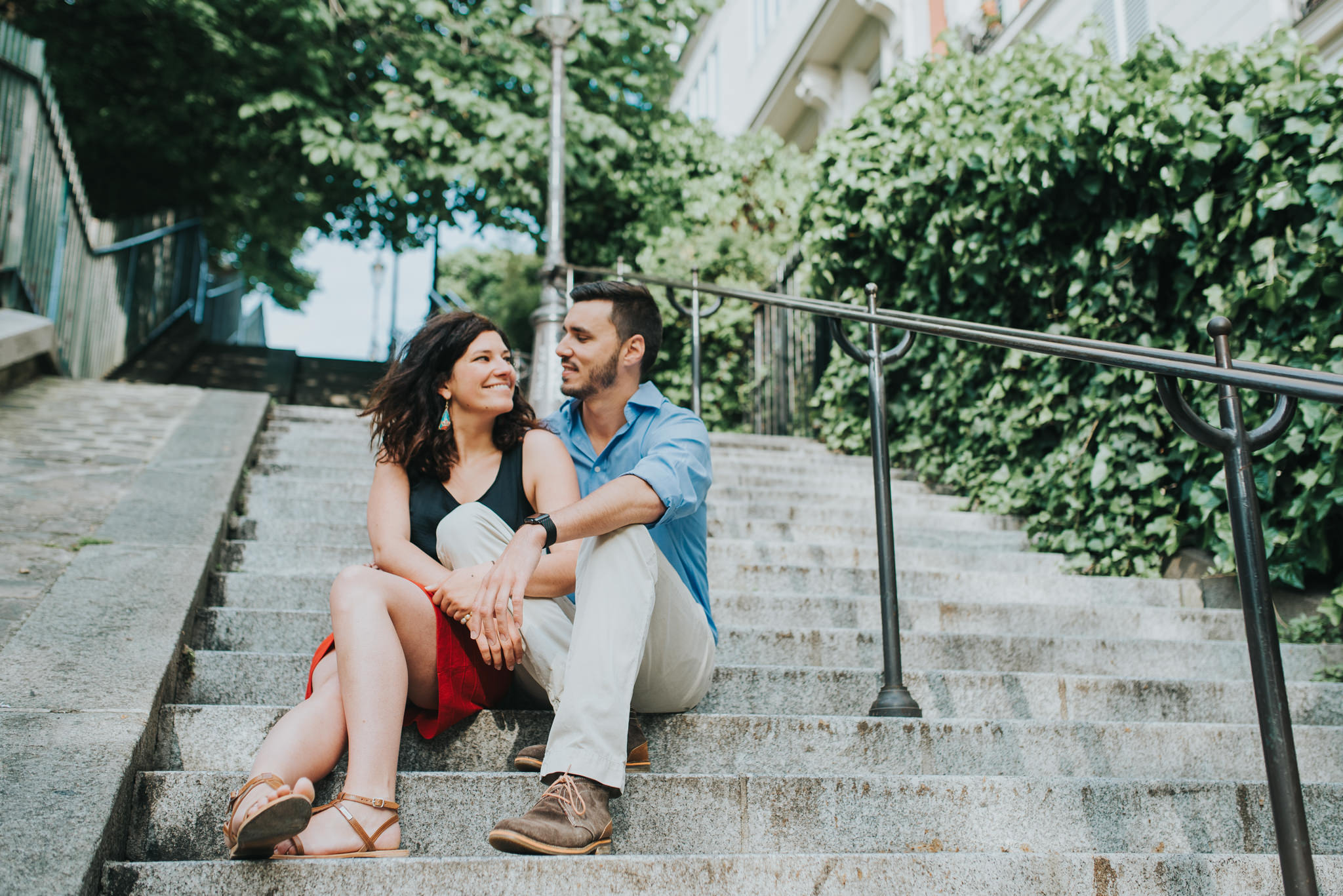 man and woman in love sitting on steps in Montmartre, Paris