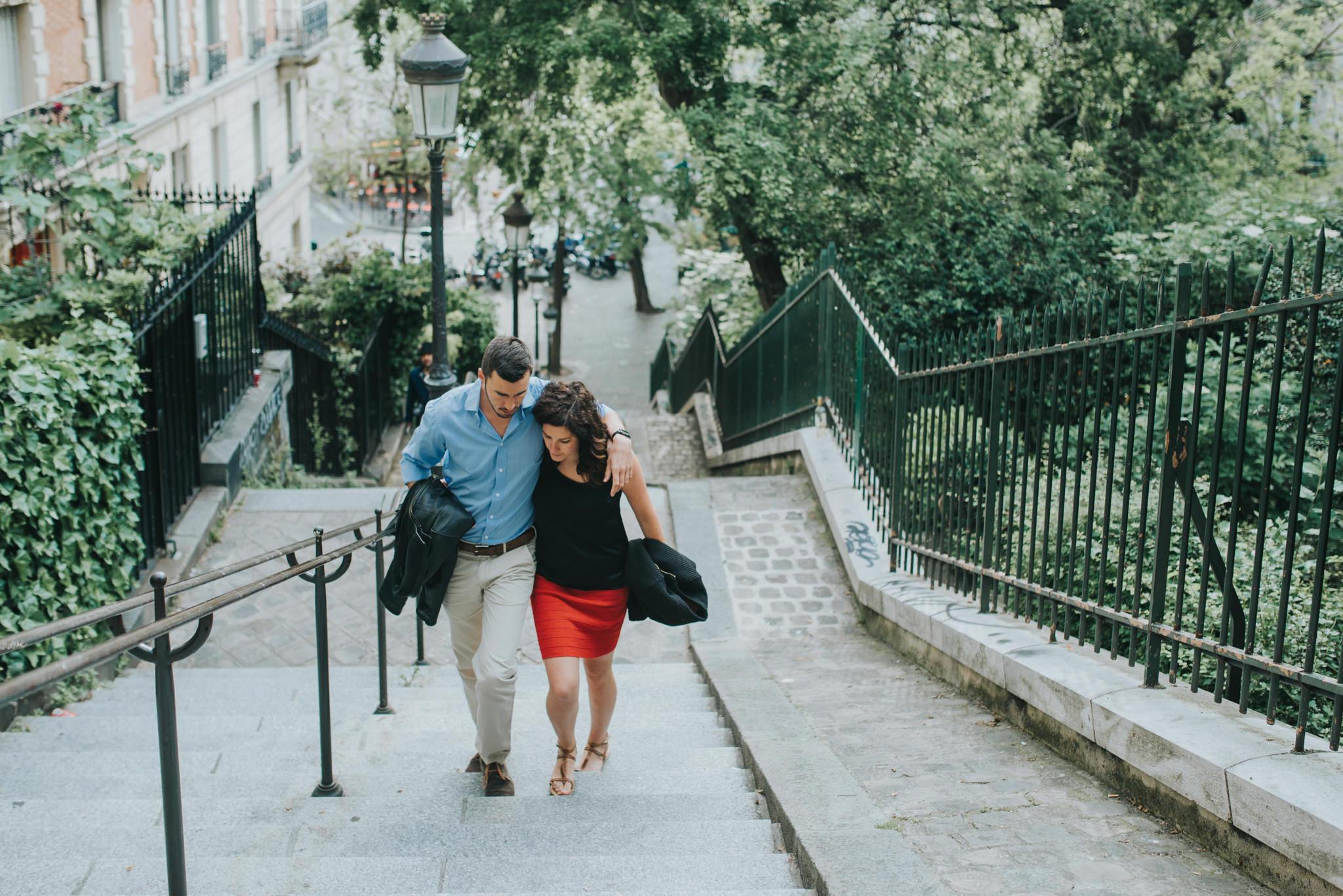 Couple in love walking up steps in Montmartre Paris
