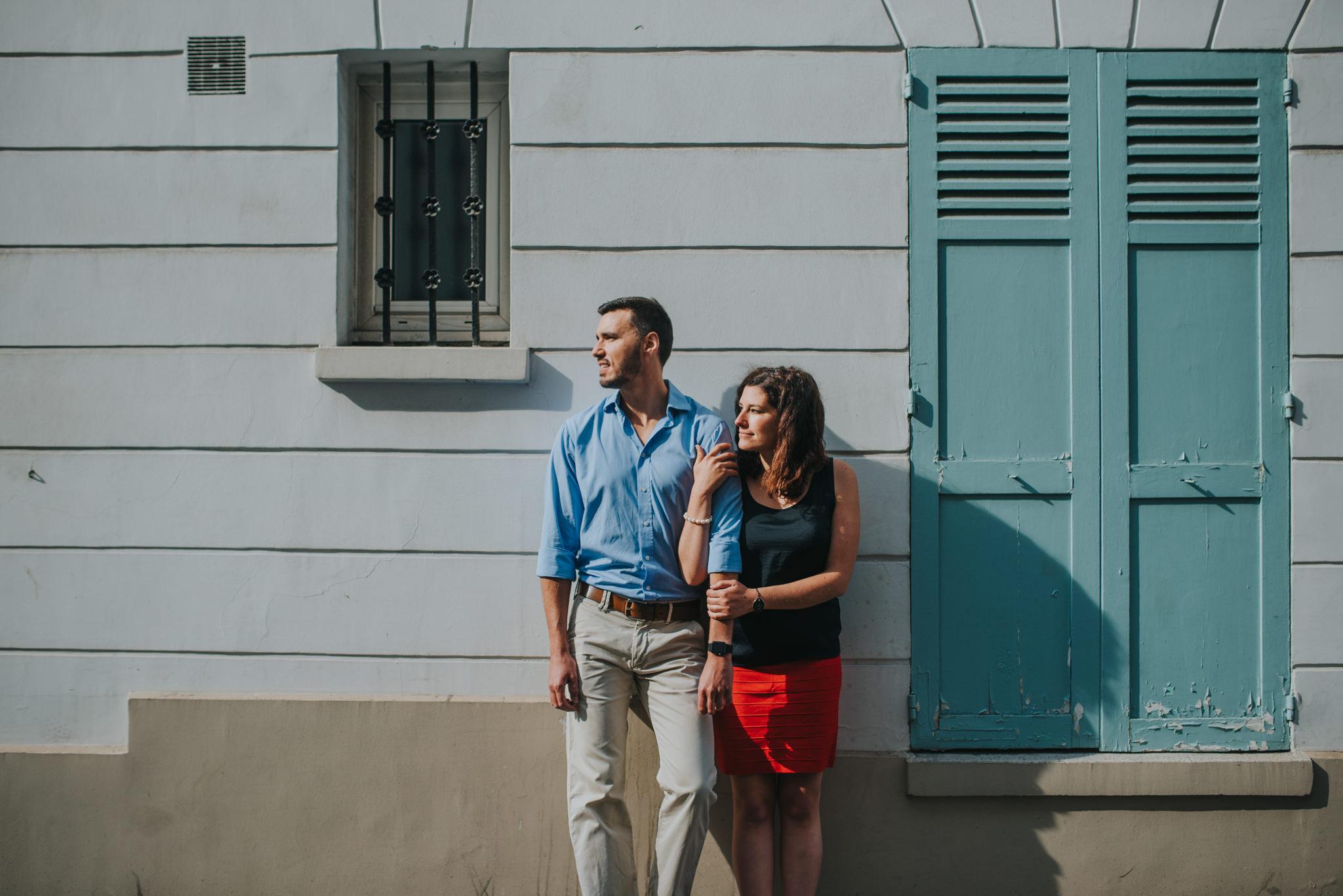Couple in love holding hands on Montmartre street Paris